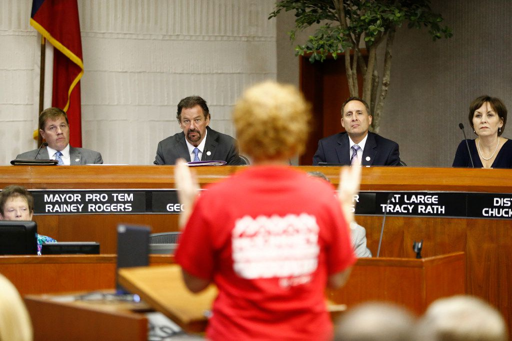 Mayor Pro Tem Rainey Rogers (from left) McKinney Mayor George Fuller, City Manager Paul Grimes and Tracy Rath listen as Shannon Raines (back of head) speaks in opposition to U.S. Highway 380  bypass during a city council meeting at City Hall in McKinney, Texas on July 18, 2017.  (Nathan Hunsinger/The Dallas Morning News)