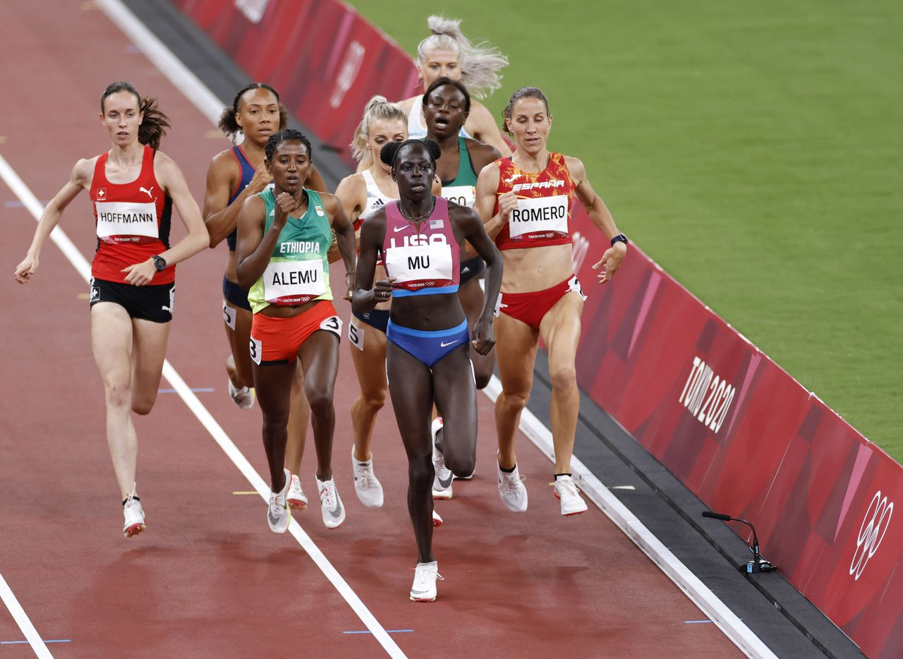 USA's Athing Mu leads the way as she competes in the women's 800 meter semifinal race during the postponed 2020 Tokyo Olympics at Olympic Stadium, on Saturday, July 31, 2021, in Tokyo, Japan. Mu finished with a time of 1:58.07 to advance to the next round. (Vernon Bryant/The Dallas Morning News)