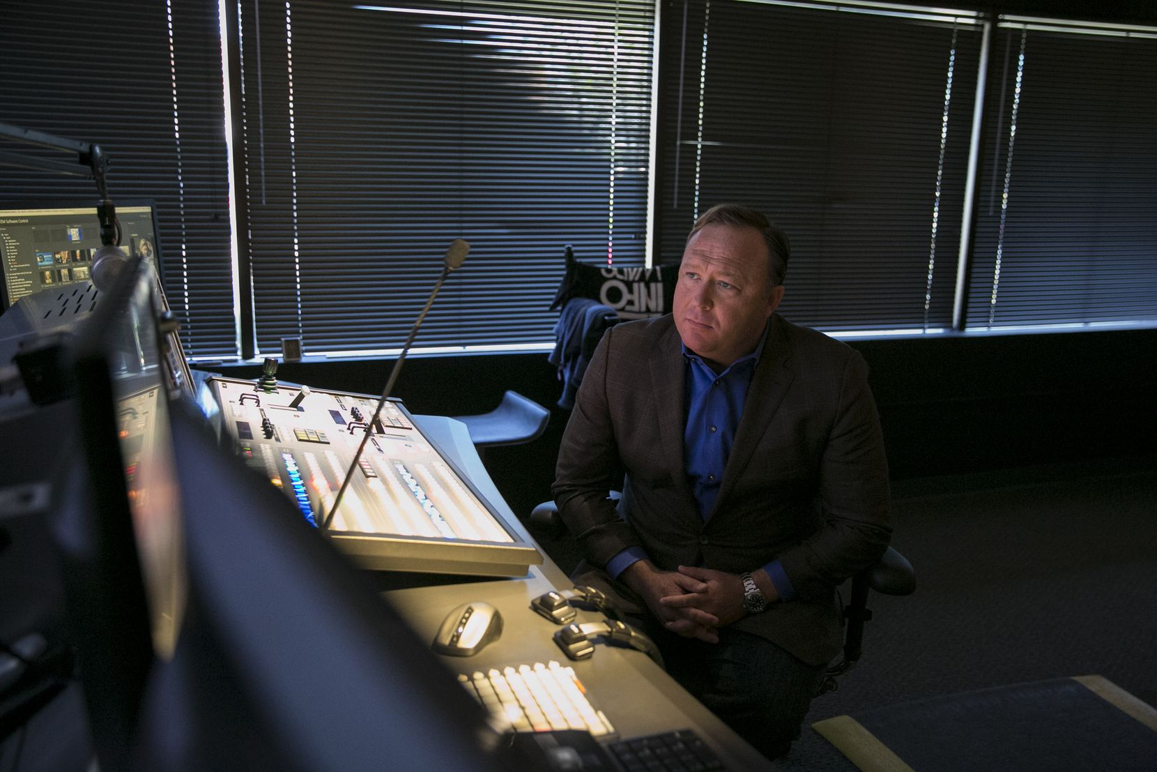 Alex Jones, conservative conspiracy theorist and operator of Infowars.com, in the control room for his right-wing radio show, in Austin. (Ilana Panich-Linsman/The New York Times)