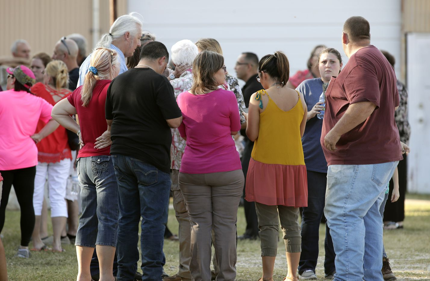 People gather near First Baptist Church following a shooting on November 5, 2017 in Sutherland Springs, Texas.