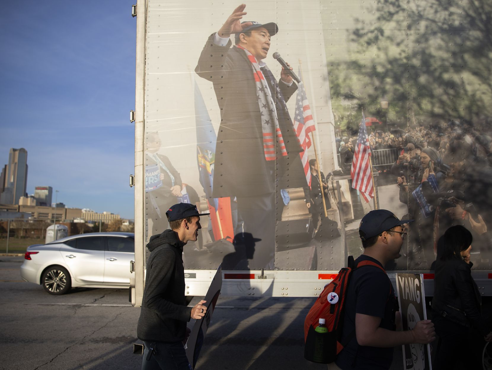Austin ÒYang GangÓ members walk by the ÒTrukerÕs for YangÓ semi before presidential candidate Andrew Yang's grassroots fundraiser at GilleyÕs Dallas on Dec. 6, 2019 in Dallas.