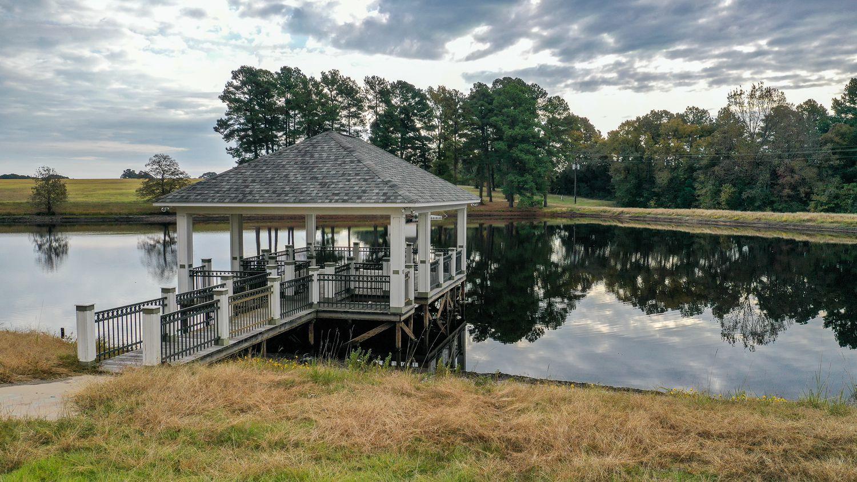 A lake and gazebo on the property.