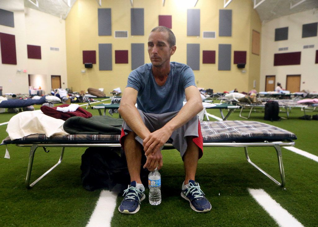 Kevin Sweet sits in his cot after taking shelter at a FEMA dome after Hurricane Harvey displaced them Aug. 30, 2017, at Tuloso-Midway High School in Corpus Christi. (Gabe Hernandez/Corpus Christi Caller-Times via AP)