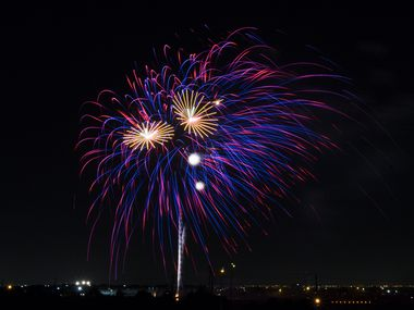 Fireworks burst during Kaboom Town festivities in Addison, Texas on July 3, 2018.