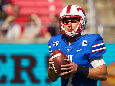 SMU quarterback Shane Buechele (7) looks to pass during the first half of an NCAA football game against Temple at Ford Stadium on Saturday, Oct. 19, 2019, in Dallas. (Smiley N. Pool/The Dallas Morning News)