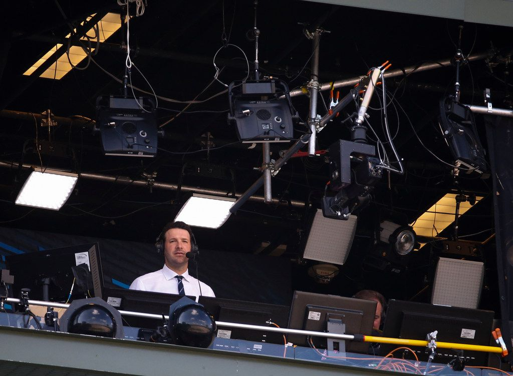 Tony Romo in the broadcast booth during the first half of an NFL football game between the Green Bay Packers and the Cincinnati Bengals Sunday, Sept. 24, 2017, in Green Bay, Wis. (AP Photo/Mike Roemer)