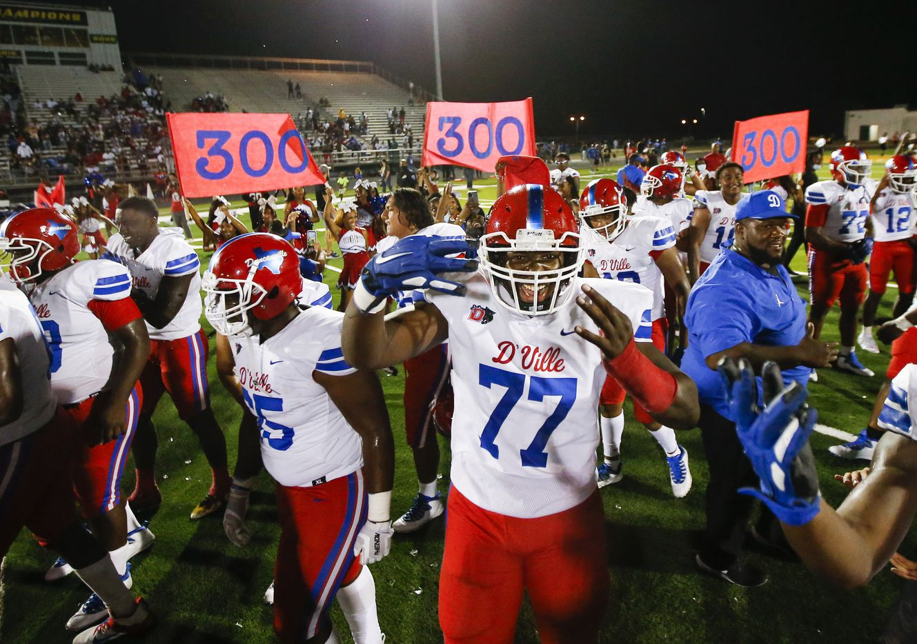 Duncanville celebrates a 42-21 win over DeSoto after a high school football game at DeSoto High School, Friday, September 17, 2021. It was Duncanville head coach Reginald Samples' 300th career win. (Brandon Wade/Special Contributor)