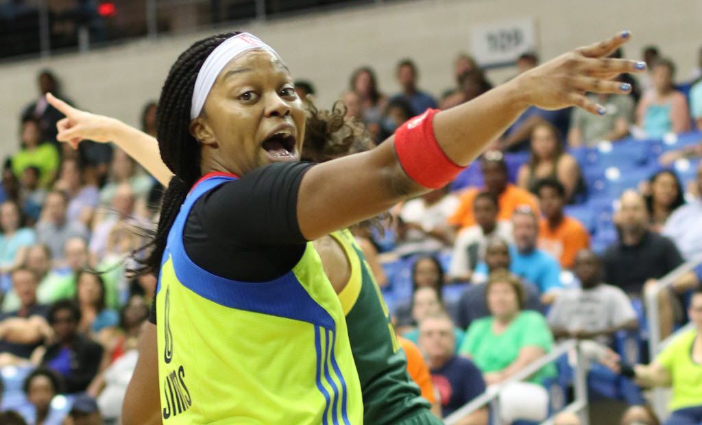Dallas Wings guard Odyssey Sims (0) vehemently makes a point as she takes the opposite view of a Seattle Storm player as the two attempted to help game officials make the decision whose possession of the ball would result during the final minute of the first half of play. The Western Conference WNBA game was held at the University of Texas at Arlington's College Park Center in Arlington, Texas on June 16, 2016.  (Steve Hamm/Special Contributor to The Dallas Morning News)