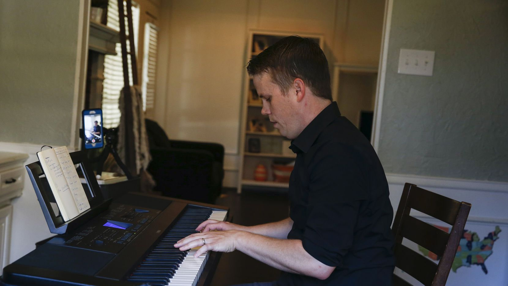 Brad Hanson, who has been playing the piano at NorthPark Mall for 11 years, plays the piano Friday, April 10, 2020, at his home in Garland, Texas. Since the mall is temporarily closed due to the new coronavirus, Hanson has been playing concerts live on Facebook to bring music into people's homes.