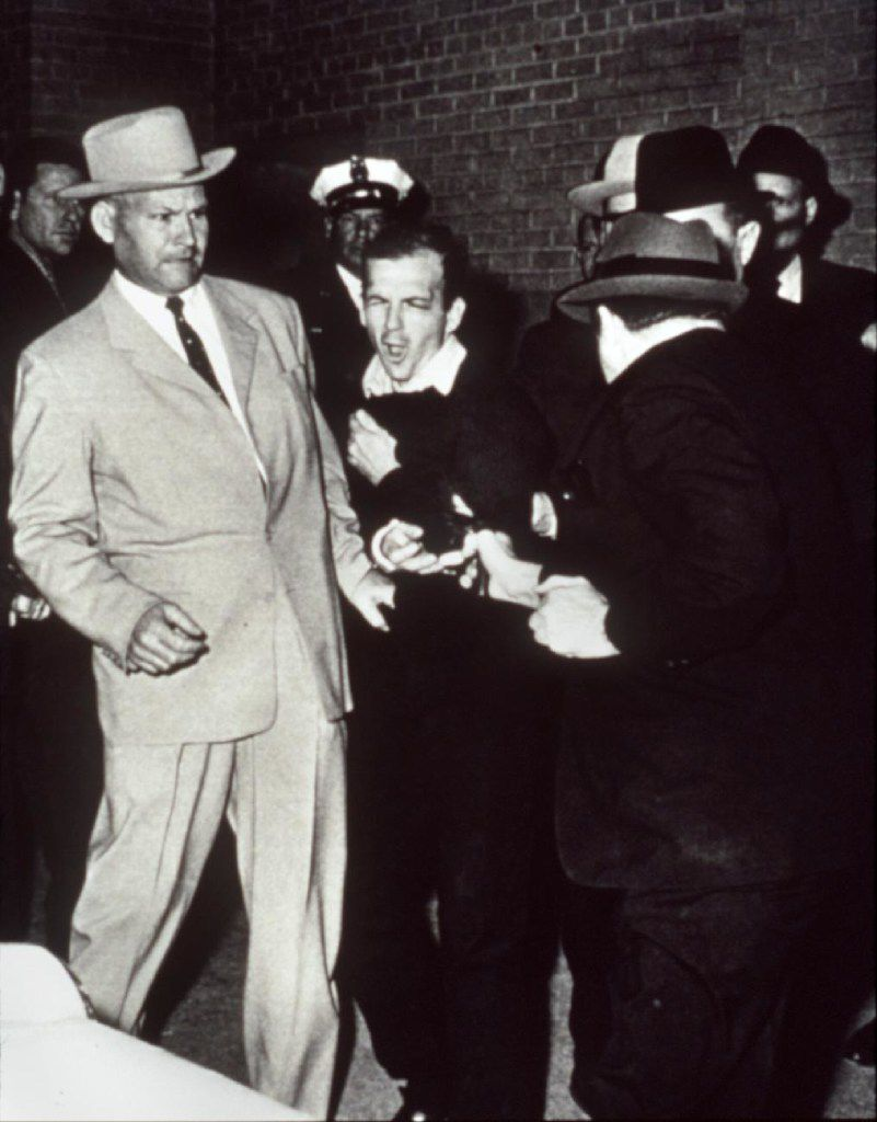 Jack Ruby shoots Lee Harvey Oswald while handcuffed to Dallas police Detective Jim Leavelle, in the light suit, in Dallas, November 24, 1963