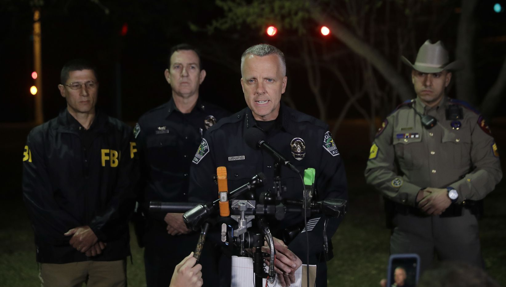 Interim Austin police Chief Brian Manley talks to the media early Monday.