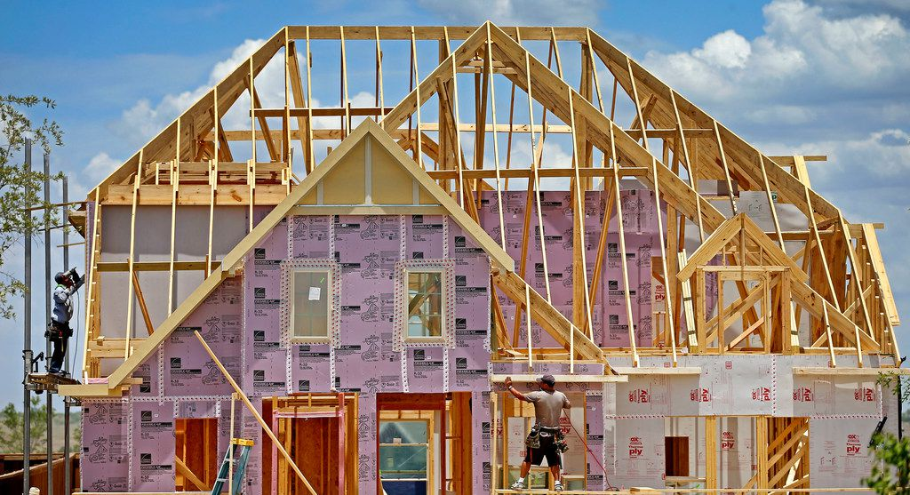 Construction workers frame new homes inside the Walsh development in Fort Worth, Texas, Thursday, July 5, 2018. The Walsh development, formerly part of Walsh Ranch, is on more than 7,000 acres. (Jae S. Lee/The Dallas Morning News)
