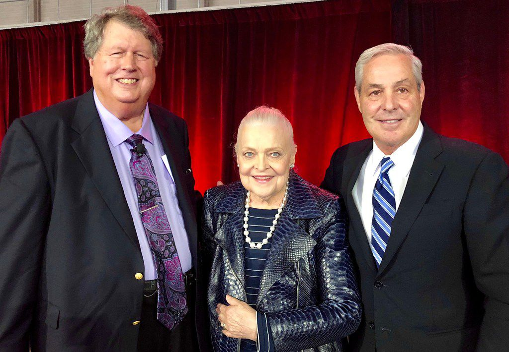 Ron Burgert (left), Ebby Halliday Cos. chief financial officer, and its CEO Mary Frances Burleson with  Ron Peltier, founder and CEO of HomeServices of America.