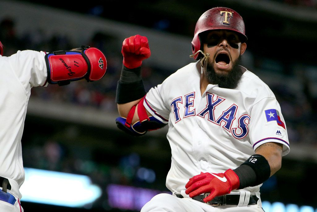 ARLINGTON, TEXAS - JUNE 18: Rougned Odor #12 of the Texas Rangers celebrates after hitting a solo home run against the Cleveland Indians in the bottom of the fifth inning at Globe Life Park in Arlington on June 18, 2019 in Arlington, Texas. (Photo by Tom Pennington/Getty Images) *** BESTPIX ***