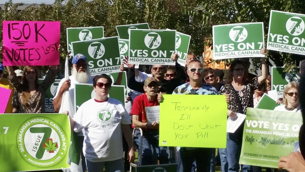 Supporters of Arkansas Issue 7, a medical marijuana initiative to allow patients with certain conditions to obtain or grow marijuana to ease their symptoms, rally outside the Arkansas Supreme Court building in Little Rock.
