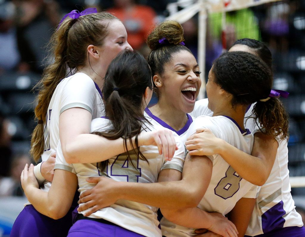 The Lamar Fulshear Chargers celebrate after scoring in the second set of a Class 4A volleyball state semifinal match against Kennedale at the Curtis Culwell Center in Garland, on Thursday, November 21, 2019. Fulshear won three straight sets 25-14, 25-11 and 25-20 to advance to the state final.