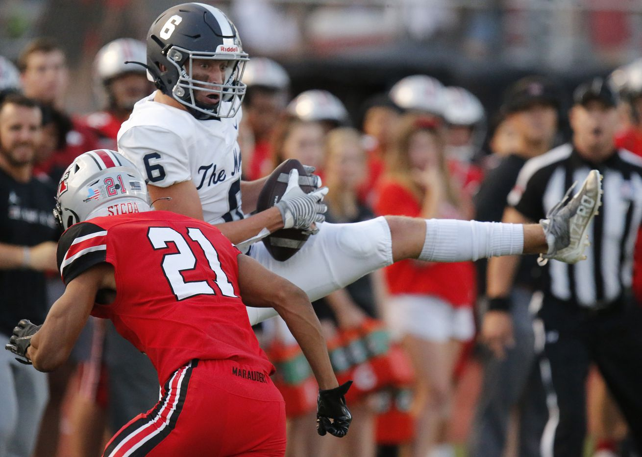 Flower Mound High School wide receiver Boston Lingenfelter (6) pulls in a pass in front of Flower Mound Marcus High School cornerback Zach Morris (21) during the first half as Flower Mound Marcus hosted Flower Mound High School in a district 6-6A football game at Marauder Stadium in Flower Mound on Friday night, September 24, 2021. (Stewart F. House/Special Contributor)