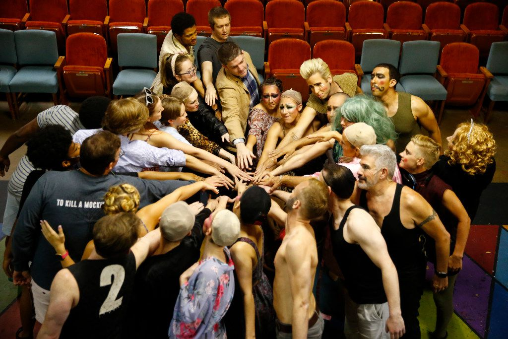 The cast of Pippin cheers before the curtain at The Firehouse Theatre in Farmers Branch on July 21.