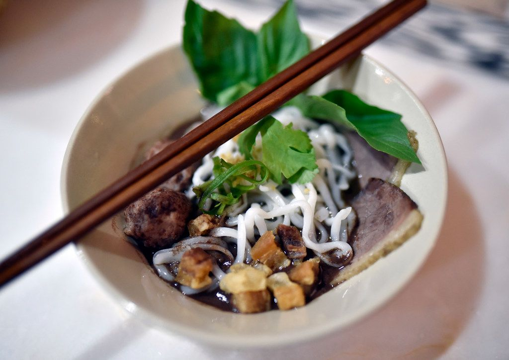 A bowl of boat noodles with pork blood broth and bone marrow during a pop-up dinner showcasing the food of Khao Noodle Shop