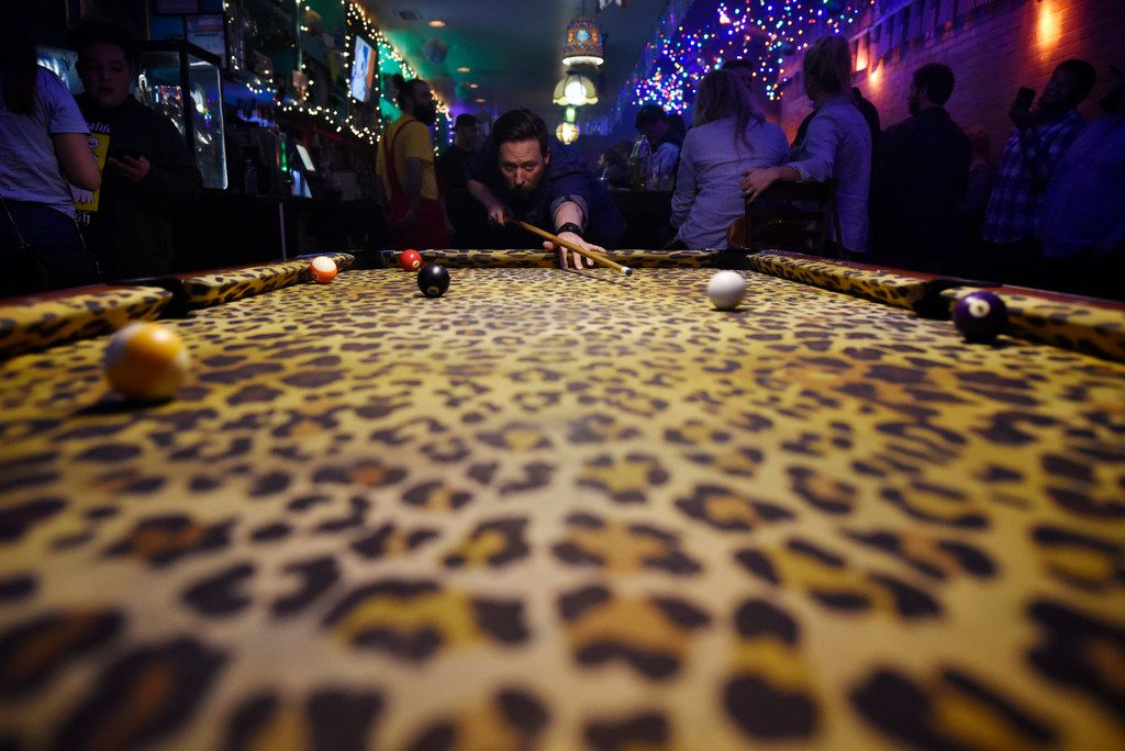 Jason Ragan, 36, of Las Colinas, plays pool on a leopard table inside the pop-up bar the Drunken Clam, Thursday night Jan. 10, 2019 in Dallas. Drunken Clam is themed after the bar in Family Guy. Ben Torres/Special Contributor
