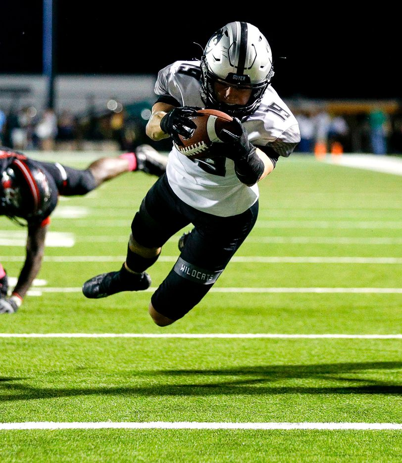 Denton Guyer wide receiver Grayson O'Bara dives into the endzone for a 5 yard touchdown run against Denton Braswell during the first half in a District 5-6A high school football game played at the C.H. Collins Complex on Friday, October 8, 2021, in Denton. (Steve Nurenberg/Special Contributor)