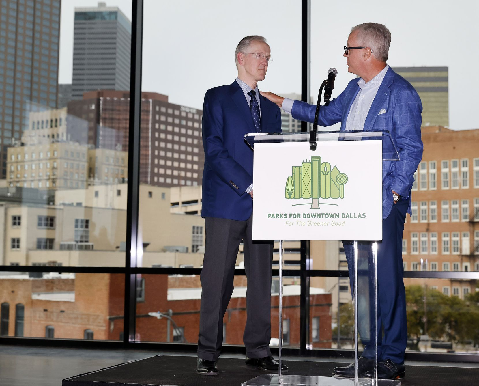 During Tuesday's ceremonial groundbreaking, East Quarter developer Shawn Todd, right, recognized the contributions Robert W. Decherd, the chairman of Parks for Downtown Dallas, has made to the city's core over the past 40 years.
