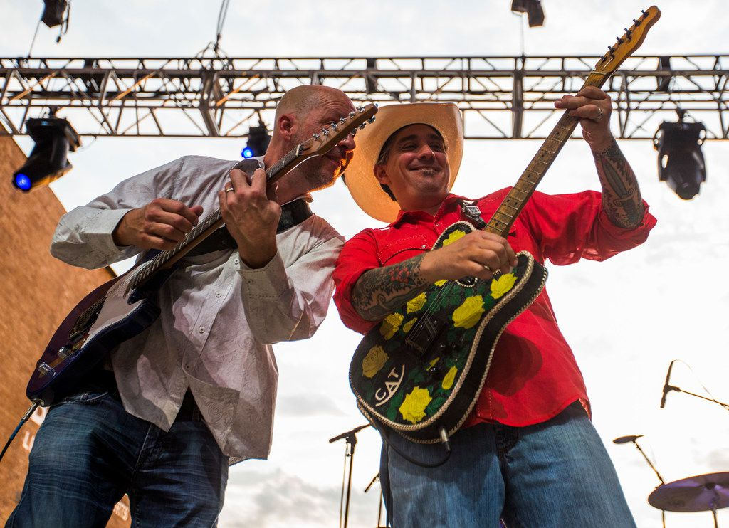 Chad Rueffer, left, and Matt Hillyer of Eleven Hundred Springs perform during the grand opening celebration the Arlington Backyard at Texas Live.