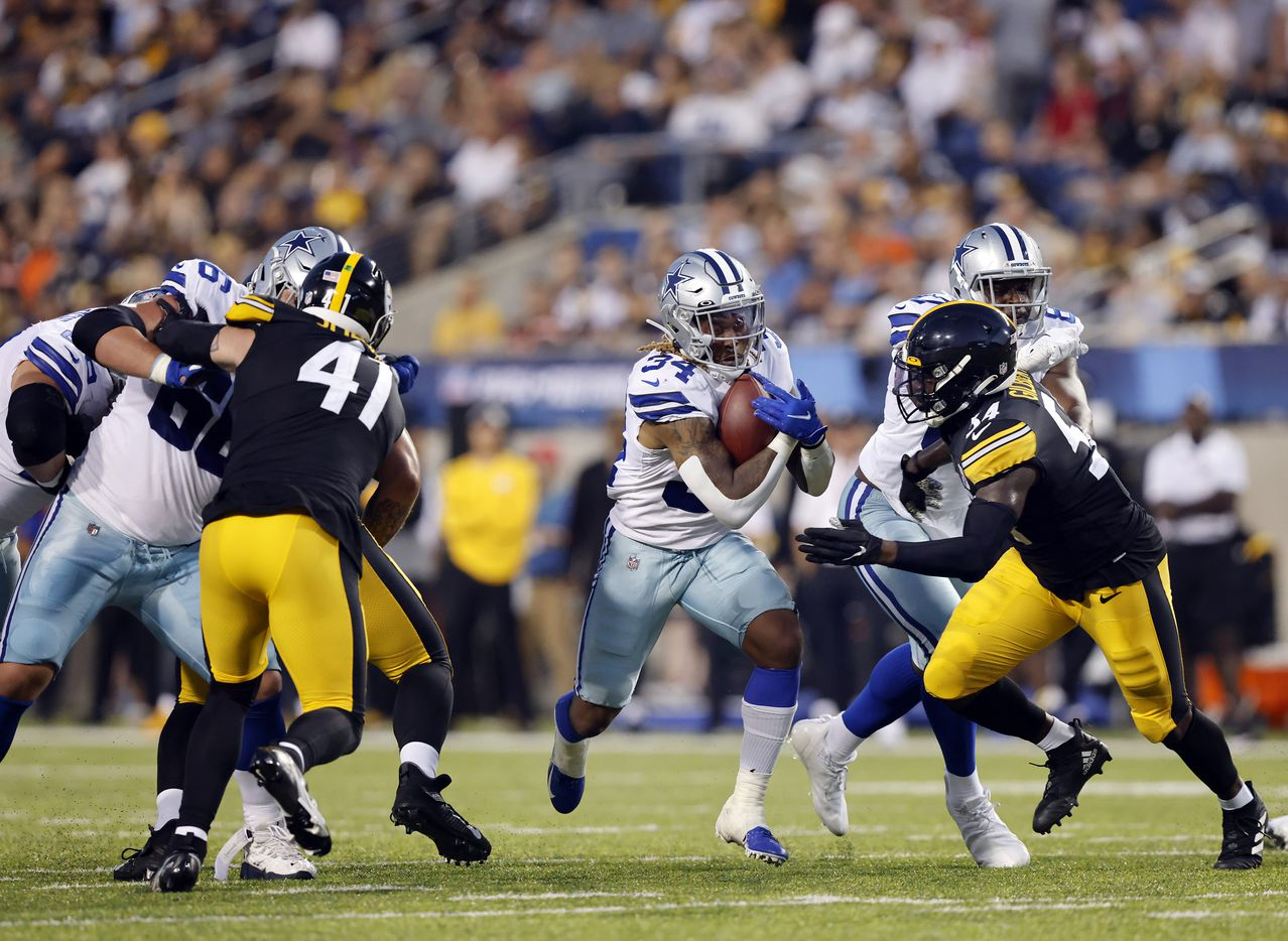 Dallas Cowboys running back Rico Dowdle (34) finds a hole in the Pittsburgh Steelers line during the first quarter of their preseason game at Tom Benson Hall of Fame Stadium in Canton, Ohio, Thursday, August 5, 2021. (Tom Fox/The Dallas Morning News)