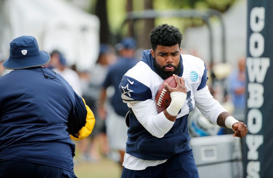 Cowboys running back Ezekiel Elliott (21) works with running backs coach Gary Brown during an afternoon practice at training camp in Oxnard, Calif., on Saturday, July 29, 2017. (Vernon Bryant/The Dallas Morning News)