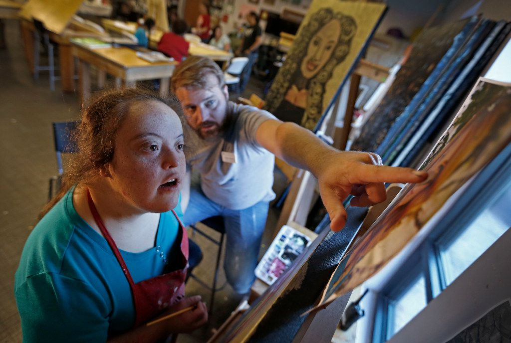 Art teacher Casey Parrott (right) helps his student Rosie Alvarado paint a portrait of actress Debbie Crawford during an art class at My Possibilities in Plano, Texas, Thursday, Sept. 29, 2016. Her painting will be on display at the show of 'Midas,' which will be presented from Oct. 7 to Oct. 23 at the Oak Cliff Cultural Center. My Possibilities has developed a partnership with a local theater company, PrismCo, and is currently creating artwork for the theater's upcoming production of 'Midas.' The artwork will be auctioned off at the Oct. 14 performance.