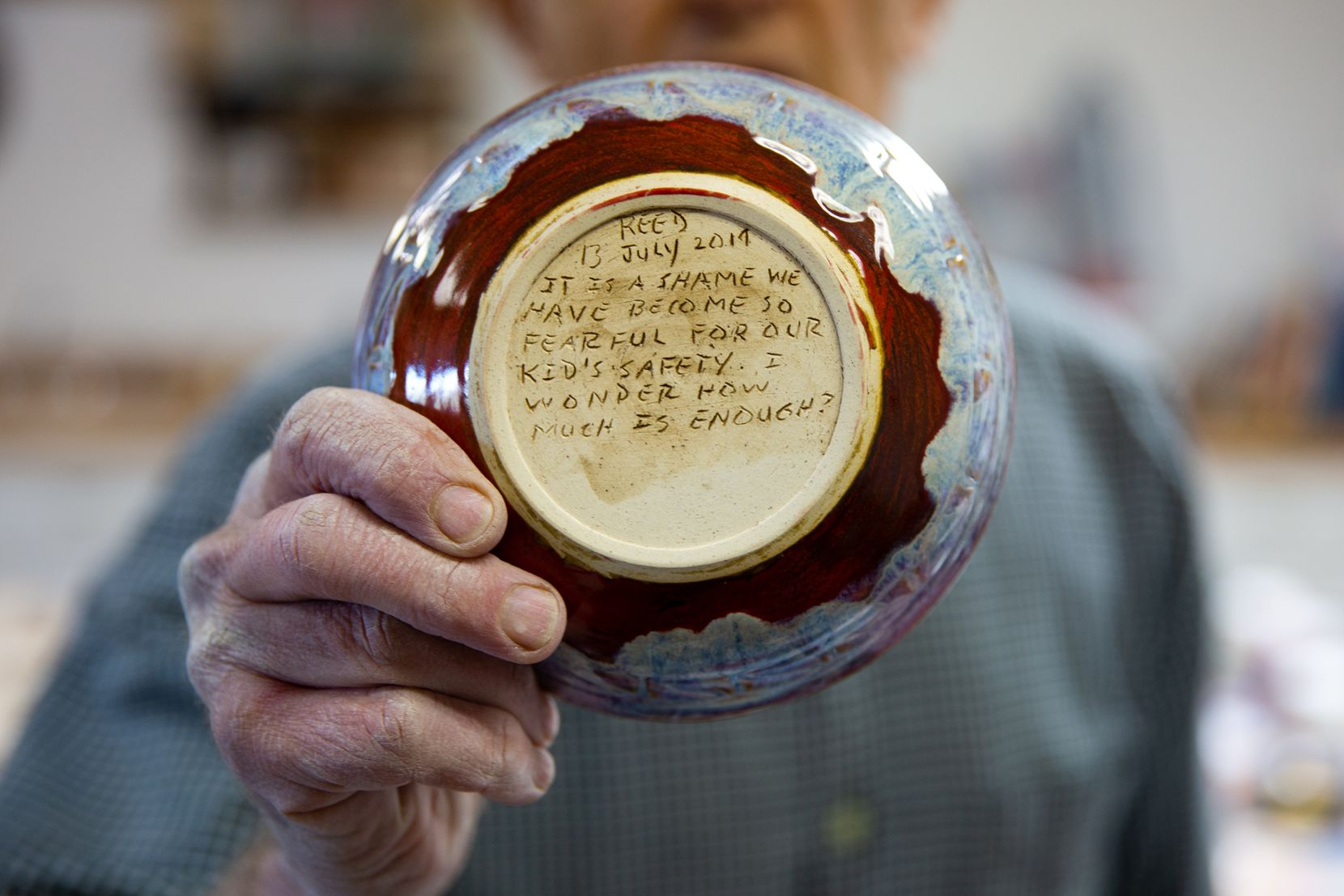 Bill Reed inscribes whimsical musings or political phrases onto the bottom of each bowl that he makes.