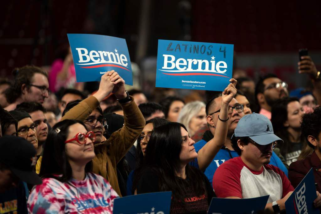 Supporters of Democratic presidential hopeful Bernie Sanders cheer during a rally at the University in Houston on February 23, 2020.