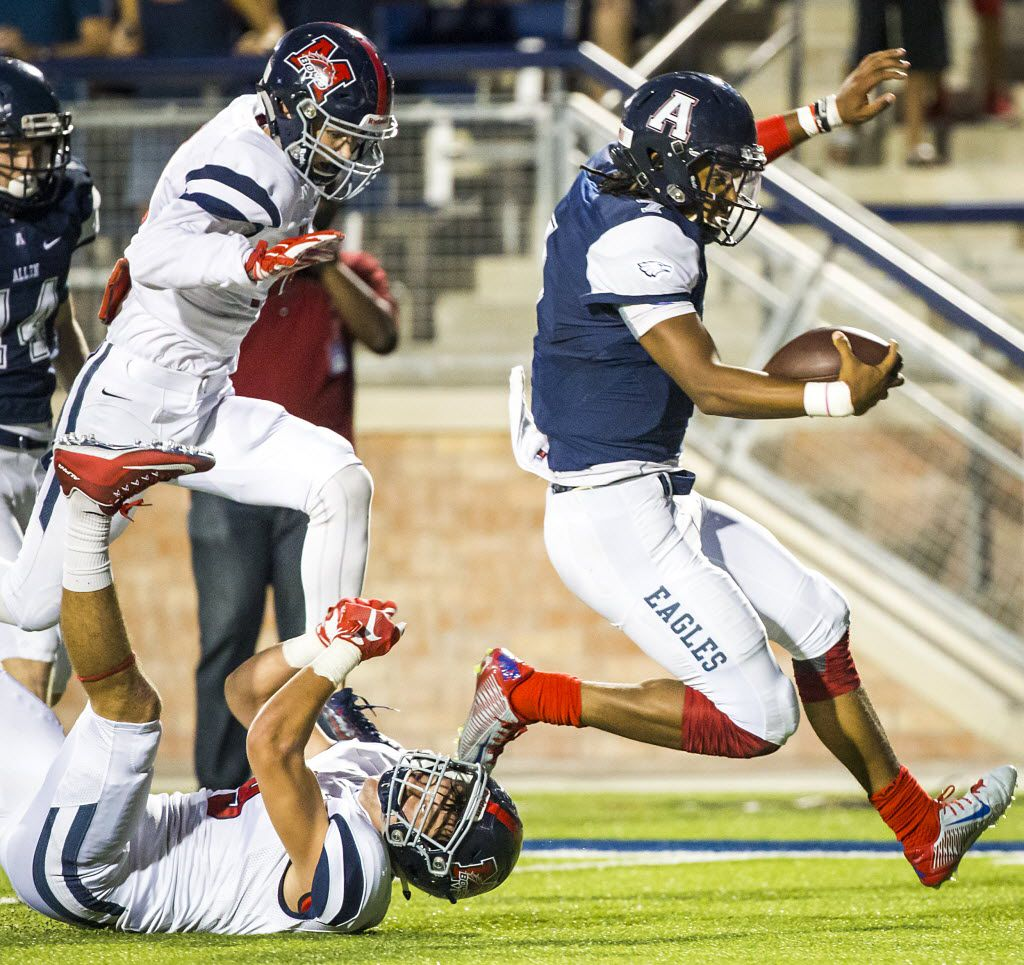 Allen quarterback Seth Green gets past the McKinney Boyd defense on a 33-yard touchdown run during the first half of a high school football game on Friday, Sept. 11, 2015, in Allen. (Smiley N. Pool/The Dallas Morning News) 09122015xPUB