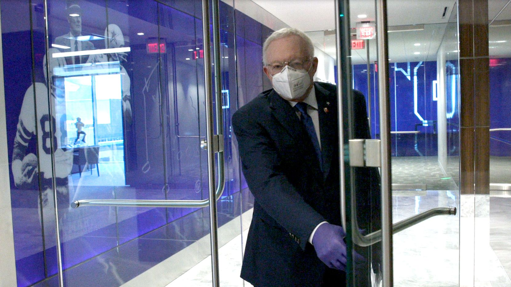 Jerry Jones appears in a video wearing a mask and gloves while being filmed at the Dallas Cowboys headquarters at The Star in Frisco, Texas, on Tuesday, May 19, 2020. Jones participated in the virtual NFL owners meeting via teleconference from The Star in Frisco. According to a statement from Dallas Cowboys spokesperson Rich Dalrymple, Jones and a contingent of Dallas Cowboys employees returned to the team headquarters for work on Tuesday.
