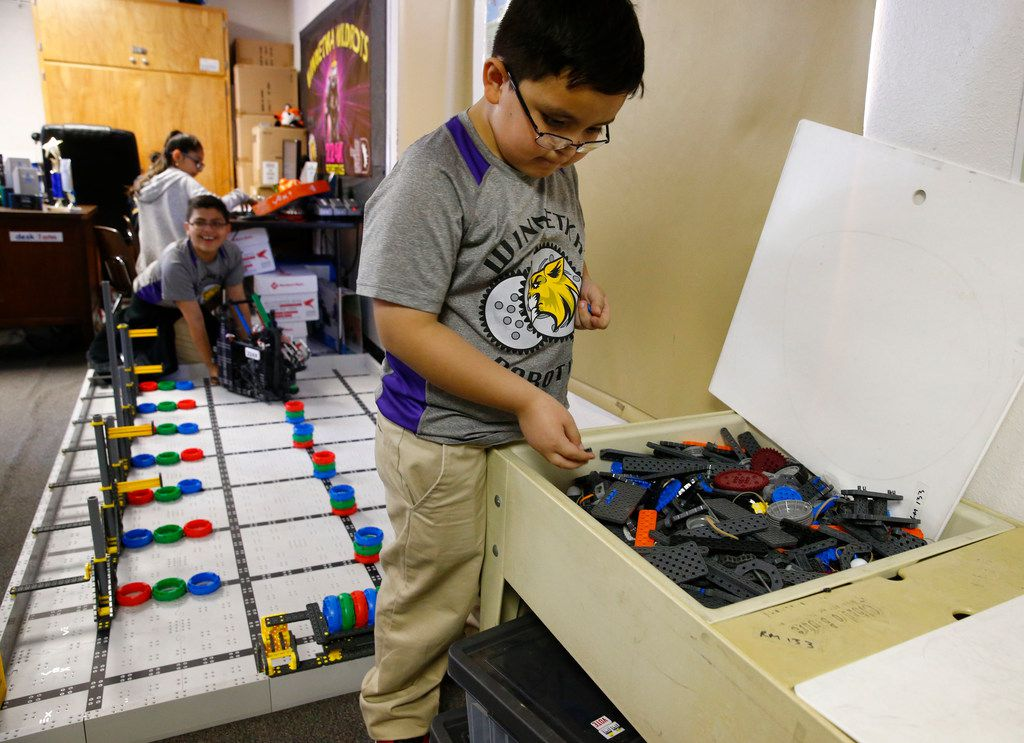 Sebastian Arriola looks for parts as he prepares for the Vex Robotics World Championship.
