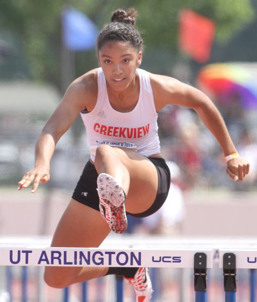 Carrollton Creekview's Melissa Gonzalez clears a hurdle on the way to her first place finish in the girls 100 meter hurdles in the Class 4A Region ll track and field meet held at UTA's Maverick Stadium in Arlington on April 28, 2012.