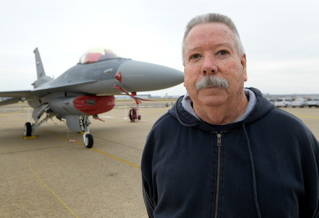 Bobby Tamplin stands next to the last F-16 to roll off the line at Lockheed Martin Aeronautics in Fort Worth on Nov. 7, 2017. It was delivered to Iraq.