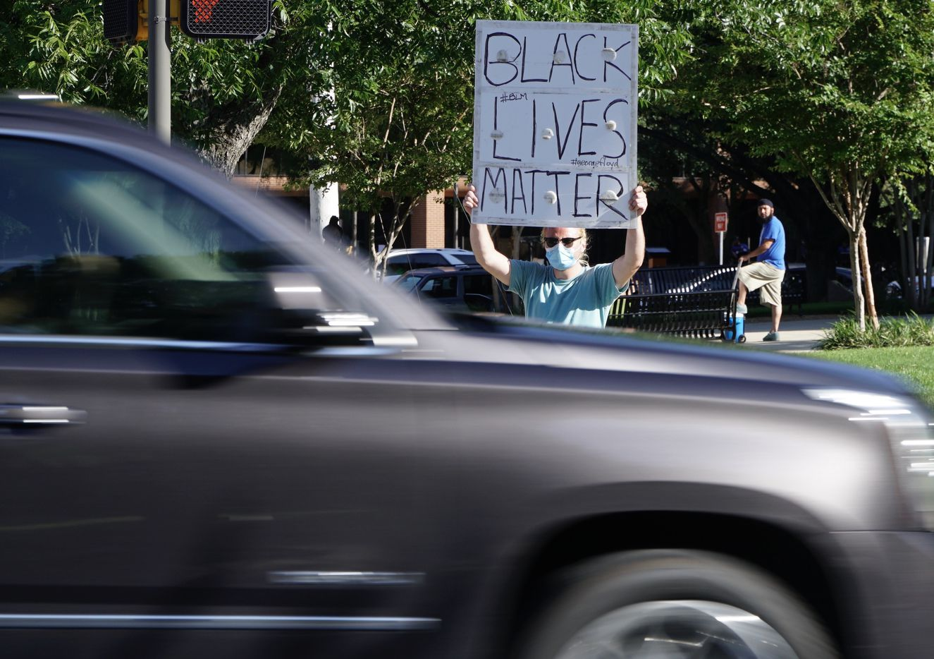 Andy Marquez was among dozens of protesters at the old courthouse in downtown Fort Worth on Friday.