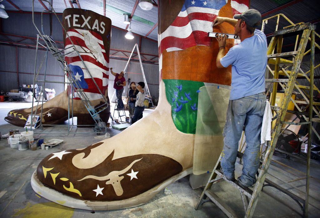 SRO scenic artist Mike Lindon draws out the details of the Texas State Capitol on one of Big Tex's new boots, August 28, 2013.