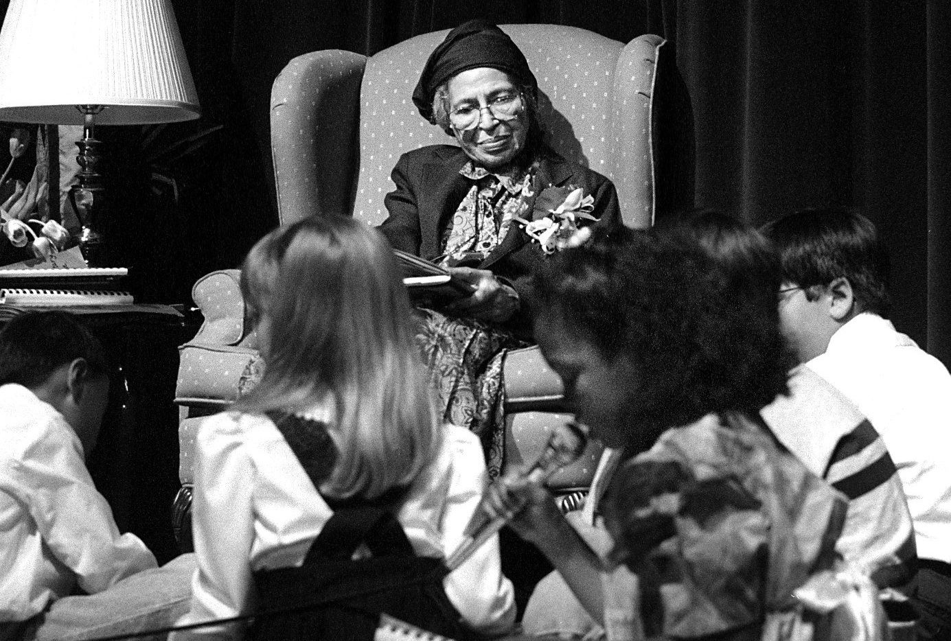 2/15/95--Civil rights leader Rosa Parks listens to second-grader Samantha Clark read a poem at Williams High School auditorium. She spoke to second-graders from Plano ISD as part of Random Acts of Kindness Week and Black History Month.