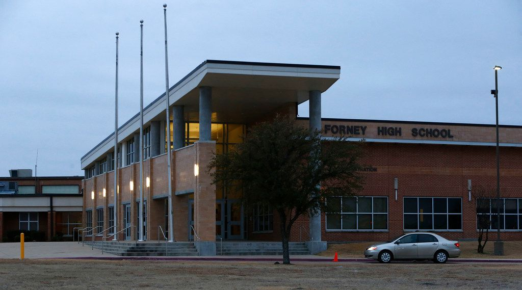 The exterior of Forney High School in Forney, Texas on Jan. 26, 2018. Four Forney High School soccer players were in custody Thursday evening after two teammates reported that they had been sexually assaulted(Nathan Hunsinger/The Dallas Morning News)