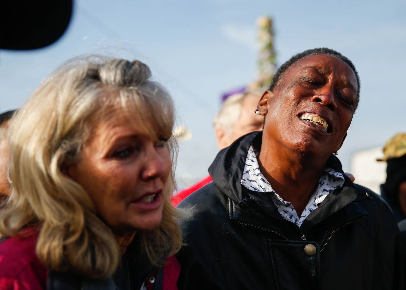Rhonda Carrington (right) and Jennifer Birdd cried during Pastor Jeffery Parker's speech about S.O.U.L. Church having to move from the downtown Dallas lot on Dec. 8, 2019.