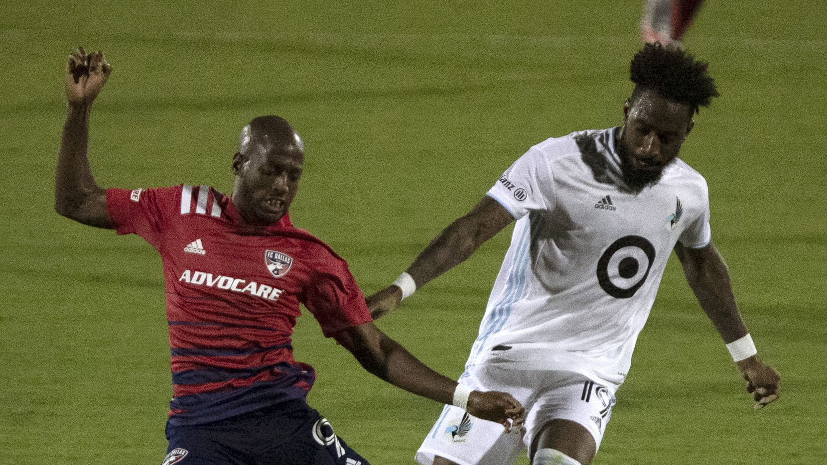FC Dallas forward Fafa Picault (9) falls after contact from Minnesota United defender Romain Metanire (19) during the second half as FC Dallas hosted Minnesota United at Toyota Stadium in Frisco on Saturday, August 29, 2020.