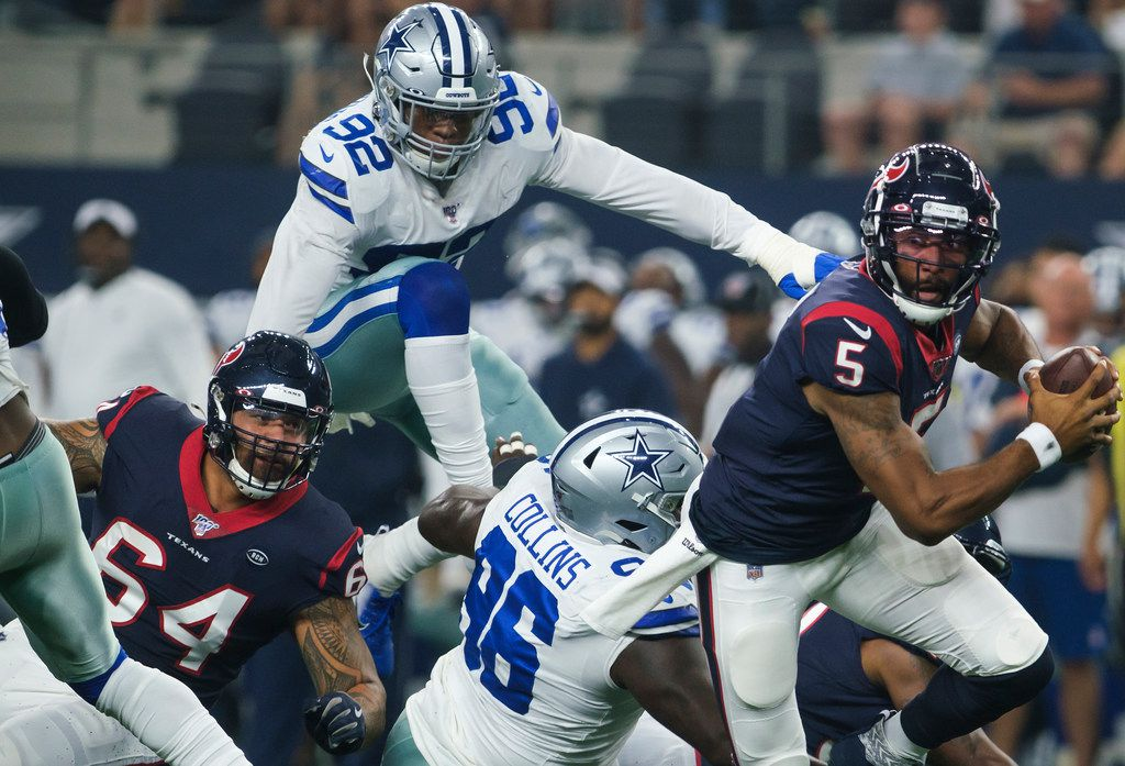 Dallas Cowboys defensive end Dorance Armstrong (92) and defensive tackle Maliek Collins (96) pressure Houston Texans quarterback Joe Webb (5) during the first quarter of an NFL preseason football game at AT&T Stadium on Saturday, Aug. 24, 2019, in Arlington, Texas. (Smiley N. Pool/The Dallas Morning News)