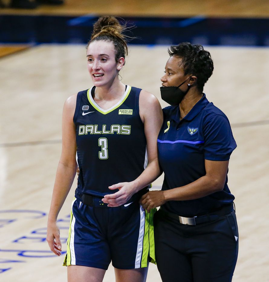 Dallas Wings guard Marina Mabrey (3) talks to coach Vickie Johnson on the sideline during the second quarter against the Los Angeles Sparks at College Park Center on Tuesday, June 1, 2021, in Arlington. (Juan Figueroa/The Dallas Morning News)