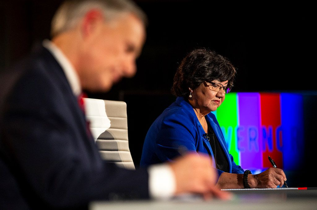 Lupe Valdez writes notes before her gubernatorial debate against Gov. Greg Abbott at the LBJ Library in Austin in September.
