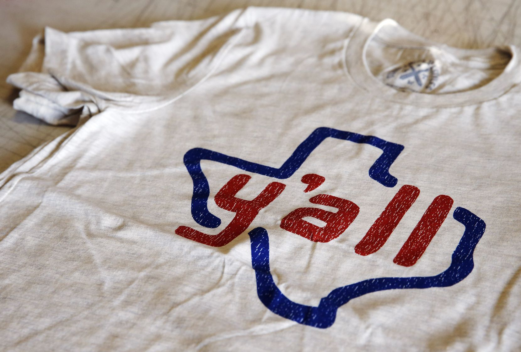 The company's T-shirt designs capture Texans' pride in their state.