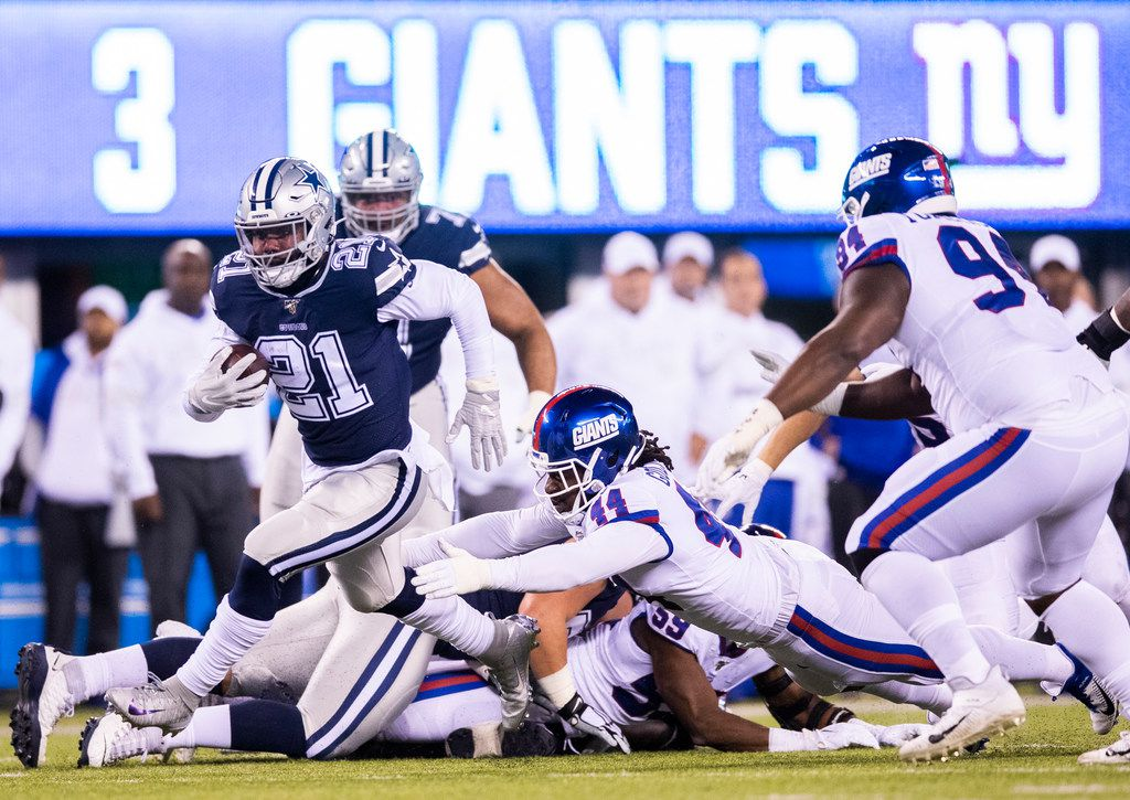Dallas Cowboys running back Ezekiel Elliott (21) outruns New York Giants linebacker Markus Golden (44) during the first quarter of an NFL game between the Dallas Cowboys and the New York Giants on Monday, November 4, 2019 at MetLife Stadium in East Rutherford, New Jersey. (Ashley Landis/The Dallas Morning News)