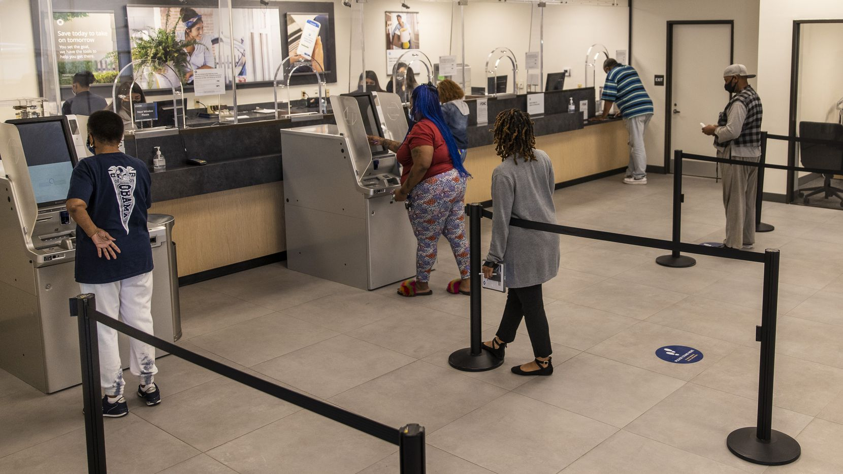 Local residents wait in line to meet with bankers at the new Chase Community Banking Center in the Oak Cliff neighborhood of Dallas on Wednesday.