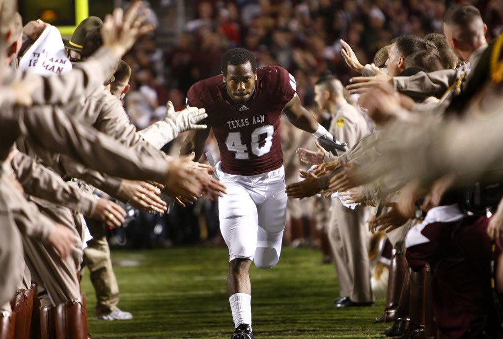 Texas A&M Aggies defensive end Von Miller (40) of DeSoto slaps hands with the Cadet Corps as he is introduced before the Nebraska Cornhuskers game at Kyle Field, Saturday, November 20, 2010. (Tom Fox/The Dallas Morning News)